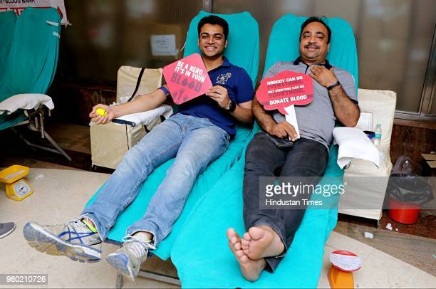Nimish Arora Director Aarone Group with Yogeshwar Sharma CEO and ED Select Citywalk donates blood during a blood donation camp organised by Aarone...