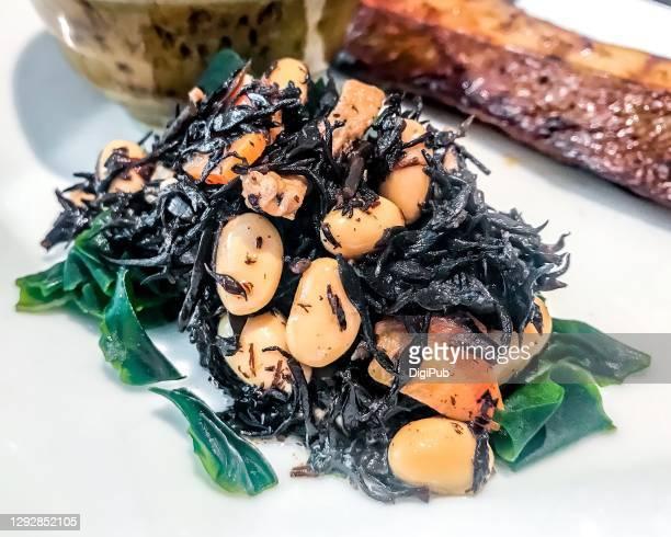 nimono of hijiki seaweed and soy bean  over wakame - 煮物 ストックフォトと画像