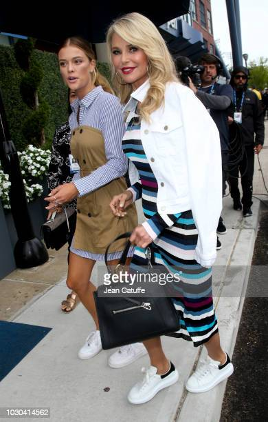 Nina Agdal and Christie Brinkley attend the men's final on day 14 of the 2018 tennis US Open on Arthur Ashe stadium at the USTA Billie Jean King...