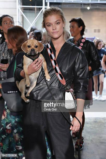 Nina Agdal and her puggle Daisy attend the Zadig & Voltaire September 2017 fashion show during New York Fashion Week at Cedar Lake on September 11,...