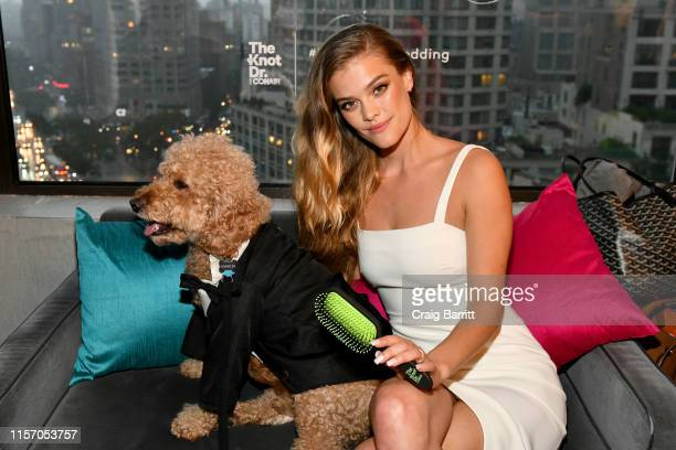 """Nina Agdal and Samson the Goldendoodle celebrate """"Knot-A-Real-Wedding"""" in honor of Conair's The Knot Dr. Detangling Brush in New York City."""