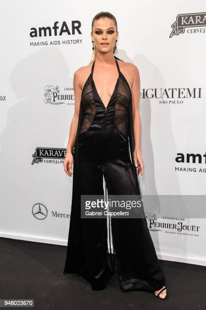 Nina Agdal attends the 2018 amfAR gala Sao Paulo at the home of Dinho Diniz on April 13 2018 in Sao Paulo Brazil