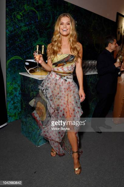 Nina Agdal is seen during the cocktail reception of amfAR Gala at La Permanente on September 22 2018 in Milan Italy