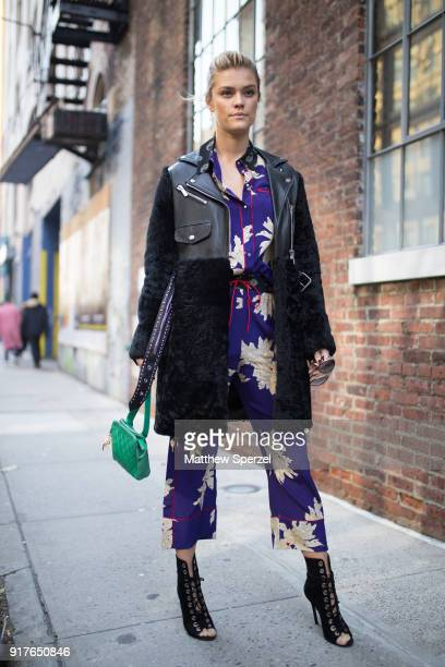 Nina Agdal is seen on the street attending Zadig Voltaire during New York Fashion Week wearing a royal blue pattern outfit with black coat on...