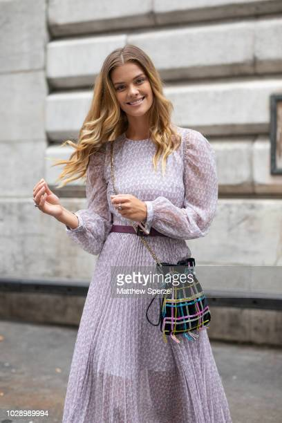 Nina Agdal is seen on the street during New York Fashion Week SS19 wearing pastel purple dress on September 7 2018 in New York City