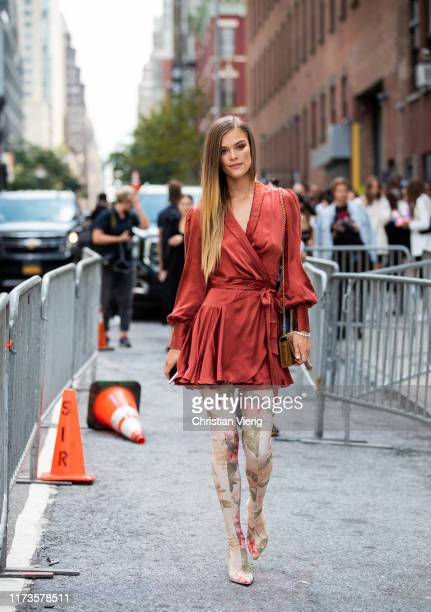 Nina Agdal is seen wearing wrapped dress overknees boots with floral print outside Zimmermann during New York Fashion Week September 2019 on...