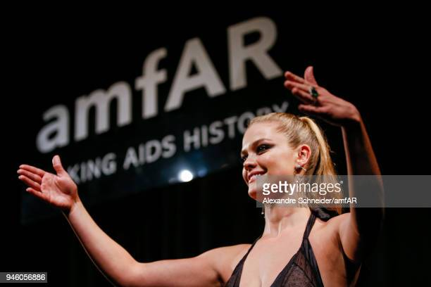 Nina Agdal speaks onstage during the 2018 amfAR gala Sao Paulo at the home of Dinho Diniz on April 13 2018 in Sao Paulo Brazil