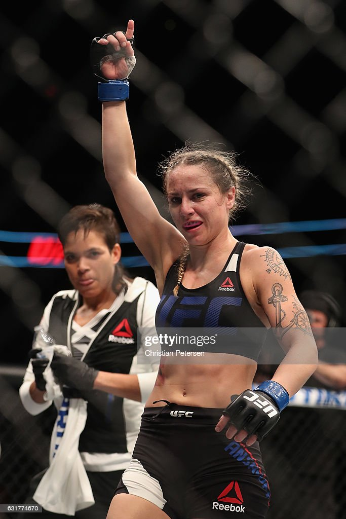 Nina Ansaroff (R) celebrates her victory over Jocelyn Jones-Lybarger (not pictured) alongside teammate/girlfriend Amanda Nunes during the UFC Fight Night event at the at Talking Stick Resort Arena on January 15, 2017 in Phoenix, Arizona.