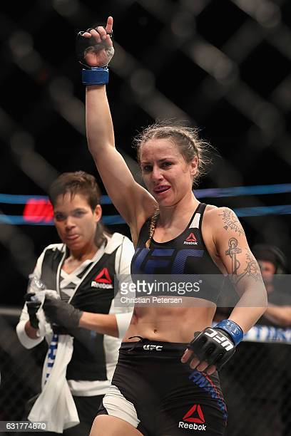 Nina Ansaroff celebrates her victory over Jocelyn JonesLybarger alongside teammate/girlfriend Amanda Nunes during the UFC Fight Night event at the at...
