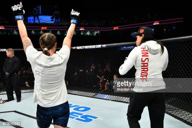 Nina Ansaroff celebrates with girlfriend Amanda Nunes after defeating Angela Hill in their women's strawweight bout during the UFC Fight Night event...