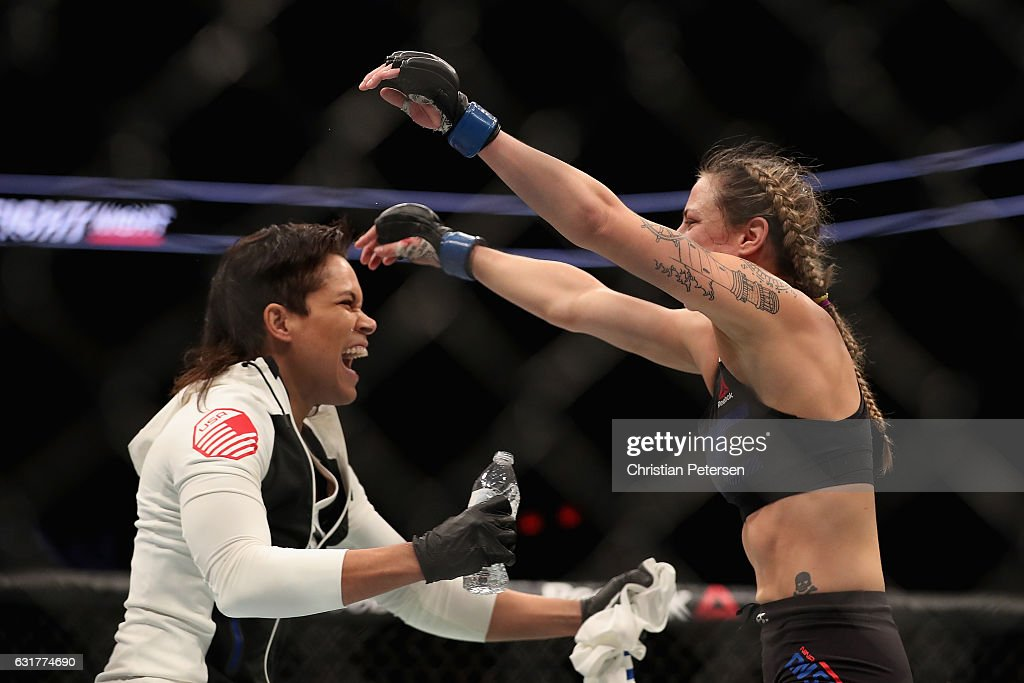 Nina Ansaroff (R) celebrates with teammate/girlfriend Amanda Nunes after defeating Jocelyn Jones-Lybarger (not pictured) during the UFC Fight Night event at the at Talking Stick Resort Arena on January 15, 2017 in Phoenix, Arizona.