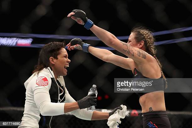 Nina Ansaroff celebrates with teammate/girlfriend Amanda Nunes after defeating Jocelyn JonesLybarger during the UFC Fight Night event at the at...