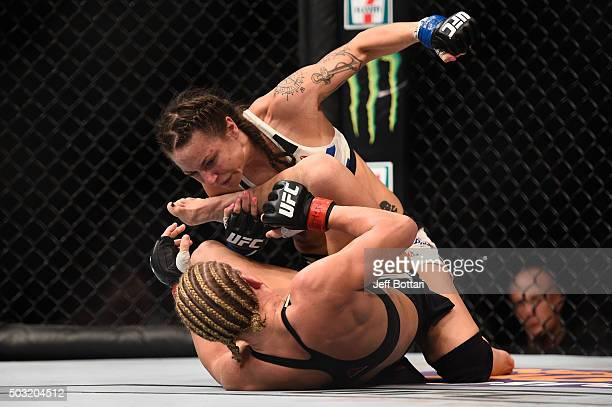 Nina Ansaroff punches Justine Kish in their women's strawweight bout during the UFC 195 event inside MGM Grand Garden Arena on January 2 2016 in Las...