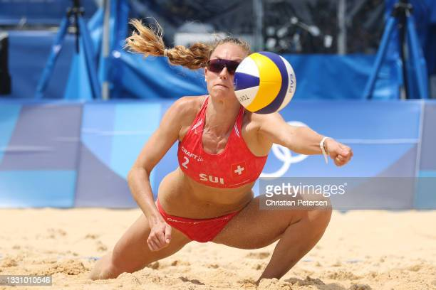 Nina Betschart of Team Switzerland returns against Team Japan during the Women's Preliminary Round - Pool F beach volleyball on day five of the Tokyo...
