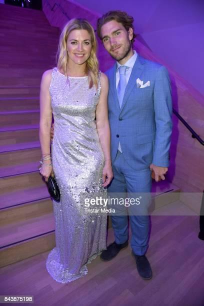 Nina Bott and her boyfriend Benjamin Baarz attend the Deutscher Radiopreis at Elbphilharmonie on September 7 2017 in Hamburg Germany