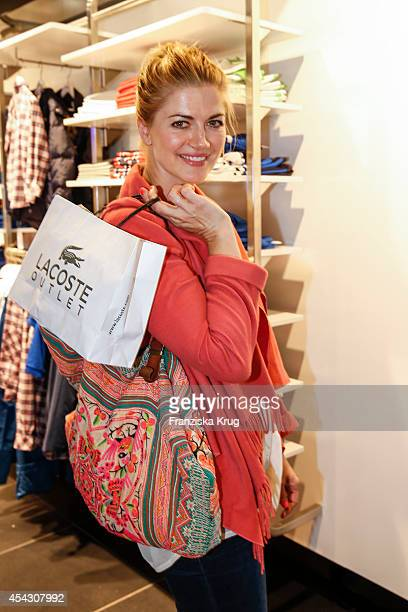 Nina Bott attends the Late Night Shopping Designer Outlet Soltau on August 28 2014 in Soltau Germany