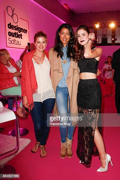 Nina Bott Rebecca Mir and Lena MeyerLandrut attend the Late Night Shopping Designer Outlet Soltau on August 28 2014 in Soltau Germany