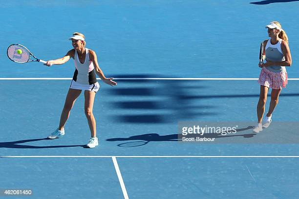 Nina Bratchikova of Russia and Barbara Schett of Austria in action in their second round doubles match against Mary Joe Fernandez of the United...