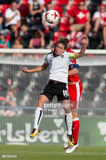 Nina Burger of Austria and Caroline Abbe of Switzerland battle for the ball during the Group C match between Austria and Switzerland during the UEFA...