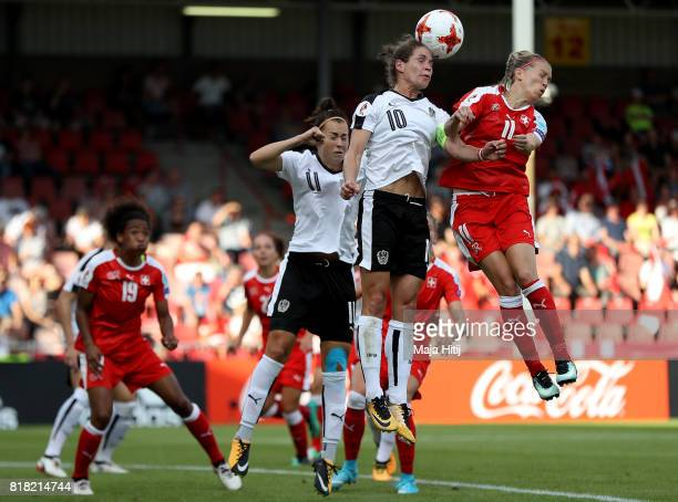 Nina Burger of Austria and Lara Dickenmann of Switzerland compete for the ball during the Group C match between Austria and Switzerland during the...