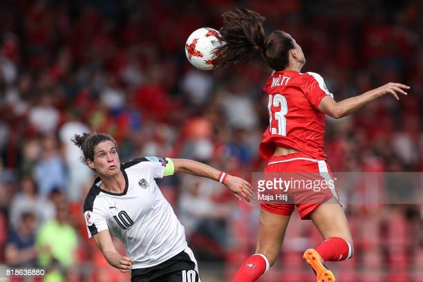 Nina Burger of Austria and Lia Walti of Switzerland battle for the ball during the Group C match between Austria and Switzerland during the UEFA...