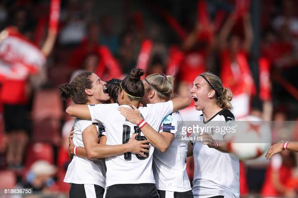 Nina Burger of Austria celebrates with a team after scoring first goal during the Group C match between Austria and Switzerland during the UEFA...