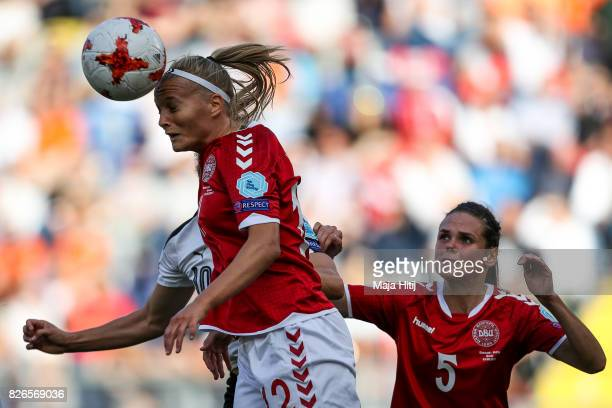 Nina Burger of Austria Stine Larsen of Denmark and Simone Boye Sorensen battle for the ball during the UEFA Women's Euro 2017 Semi Final match...