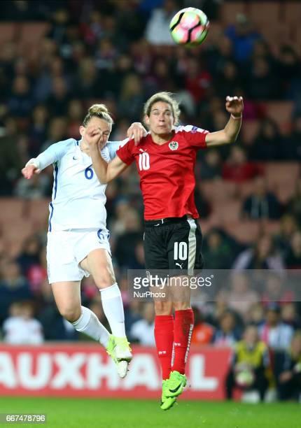 Nina Burger of Austria Women's beats England Women's Laura Bassett during International Friendly match between England Women and Austria Women at...