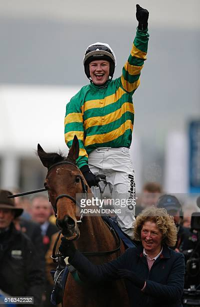 Nina Carberry celebrates as she comes into the winner's enclosure on On The Fringe after winning the Foxhunter Chase on the final day of the...