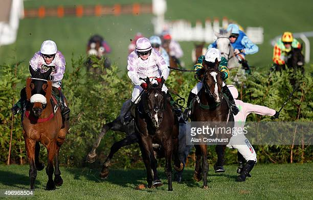 Nina Carberry riding Josies Orders clear the last to win The Glenfarclas Cross Country Steeple Chase as Katie walsh Riding Dogora fall at Cheltenham...
