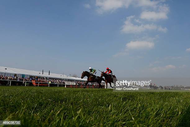 Nina Carberry riding On The Fringe clear the last to win Crabbie's Fox Hunters' Steeple Chase on day one of the three day Grand National meeting at...