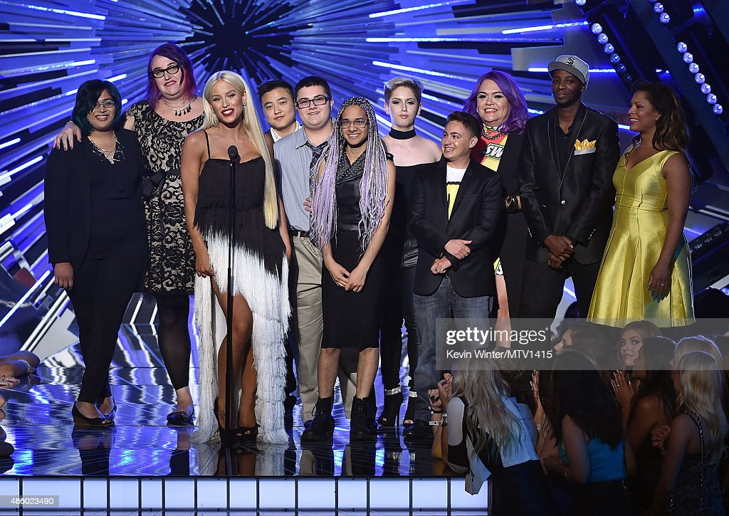 Nina Chaubal, Greta Gustava Martela, Gigi Loren Lazzarato, Leo Sheng, AJ Lehman, Tyler Ford, Hailey Jordan, Brenden Jordan, Marianna Marroquin, Myles Bradley and Precious Jordan of Happy Hippie Foundation speak onstage during the 2015 MTV Video Music Awards at Microsoft Theater on August 30, 2015 in Los Angeles, California.