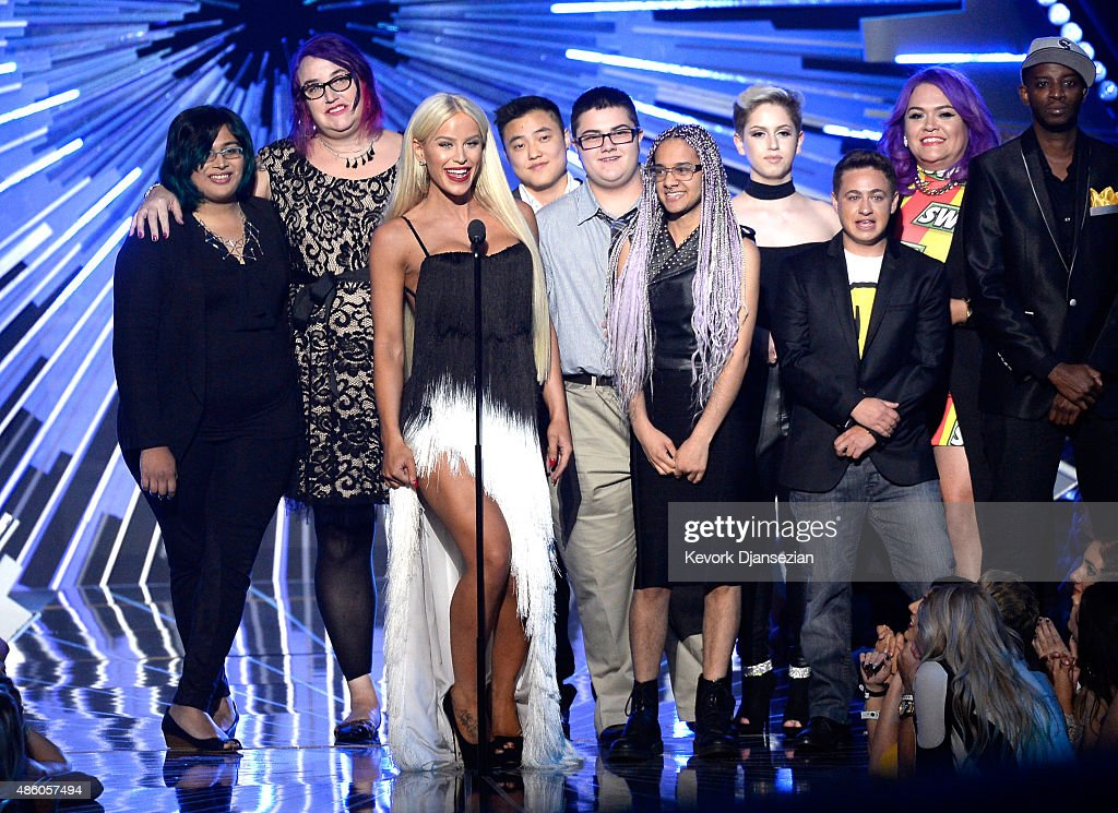 Nina Chaubal, Greta Gustava Martela, Gigi Loren Lazzarato, Leo Sheng, AJ Lehman, Tyler Ford, Hailey Jordan, Brenden Jordan, Marianna Marroquin and Myles Bradley of Happy Hippie Foundation speak onstage during the 2015 MTV Video Music Awards at Microsoft Theater on August 30, 2015 in Los Angeles, California.