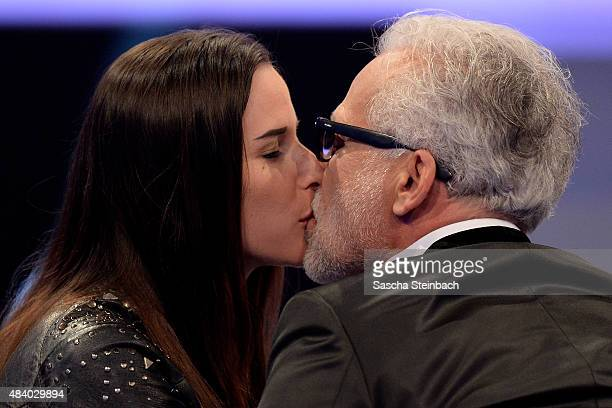 Nina de Angelo kisses his wife Larissa during the first live show of Promi Big Brother 2015 at MMC studios on August 14 2015 in Cologne Germany