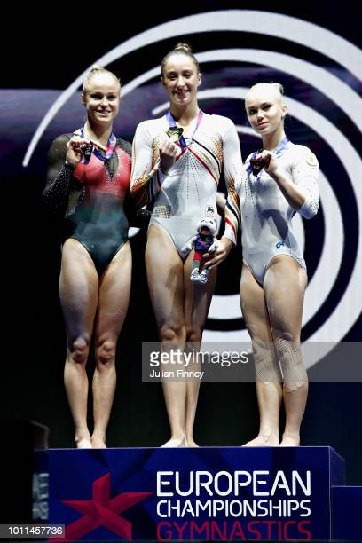 Nina Derwael of Belgium Jonna Adlerteg of Sweden and Angelina Melnikova of Russia are presented with their medals in the Women's Individual Uneven...