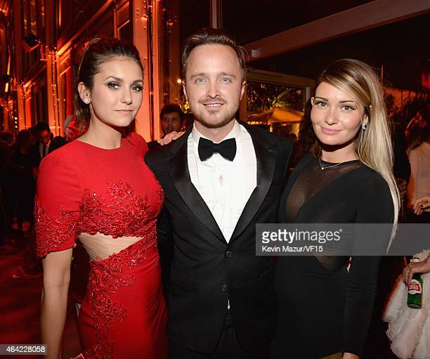 Nina Dobrev Aaron Paul and Lauren Parsekian attend the 2015 Vanity Fair Oscar Party hosted by Graydon Carter at the Wallis Annenberg Center for the...