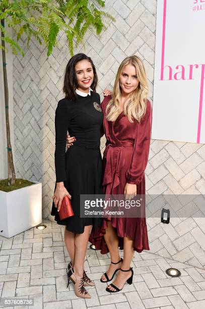 Nina Dobrev and Claire Holt attend Nina Dobrev celebrates the harper by Harper's BAZAAR September Issue with an Event Presented By Sephora In LA at...