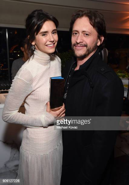 Nina Dobrev and Clifton Collins Jr celebrate with Belvedere Vodka at Vanity Fair and Lancome Paris Toast Women in Hollywood hosted by Radhika Jones...
