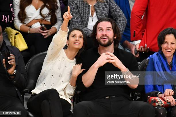 Nina Dobrev and Grant Mellon attend a basketball game between the Los Angeles Lakers and the Washington Wizards at Staples Center on March 26 2019 in...
