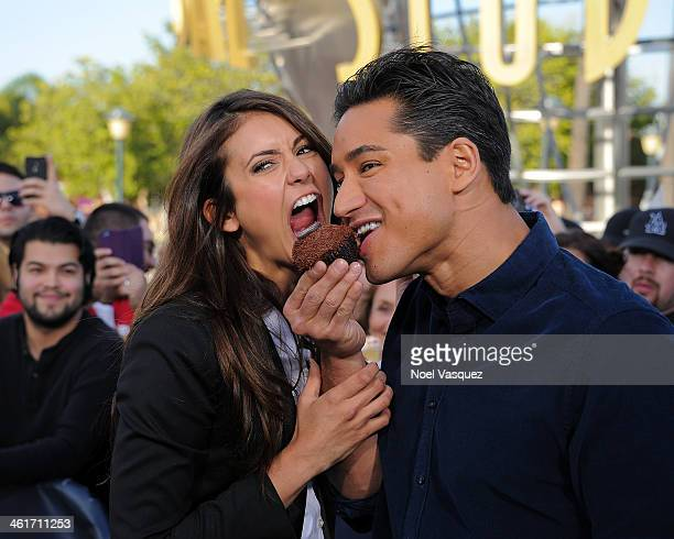 Nina Dobrev and Mario Lopez visit 'Extra' at Universal Studios Hollywood on January 10 2014 in Universal City California
