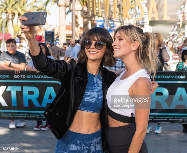Nina Dobrev and Renee Bargh pose together at 'Extra' at Universal Studios Hollywood on December 15 2017 in Universal City California
