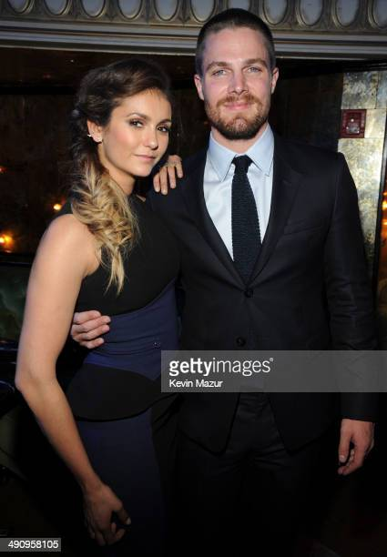 Nina Dobrev and Stephen Amell attend The CW Network's 2014 Upfront party at Paramount Hotel on May 15 2014 in New York City