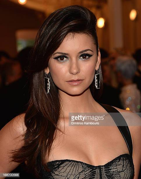Nina Dobrev attends the 2013 Costume Institute Gala PUNK Chaos to Couture at Metropolitan Museum of Art on May 6 2013 in New York City