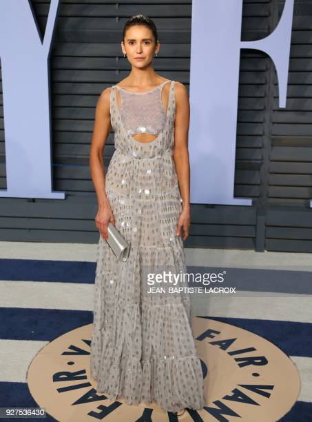 Nina Dobrev attends the 2018 Vanity Fair Oscar Party following the 90th Academy Awards at The Wallis Annenberg Center for the Performing Arts in...