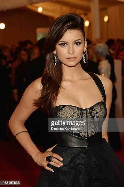 Nina Dobrev attends the Costume Institute Gala for the PUNK Chaos to Couture exhibition at the Metropolitan Museum of Art on May 6 2013 in New York...