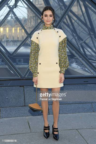 Nina Dobrev attends the Louis Vuitton show as part of the Paris Fashion Week Womenswear Fall/Winter 2019/2020 on March 05, 2019 in Paris, France.