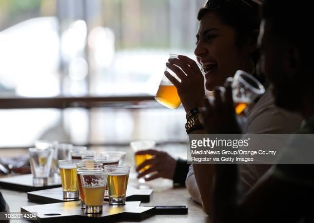 Nina Duran laughs as she enjoys a beer at Angel City Brewery in Los Angeles, Calif. On Saturday, May 25, 2013.