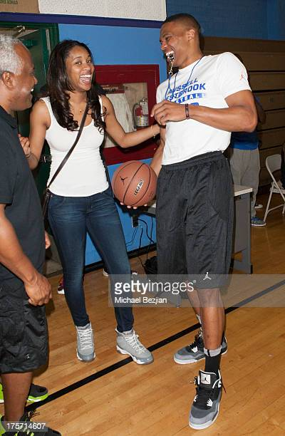 Nina Earl and Russell Westbrook attend Russell Westbrook Why Not Basketball Camp at Jesse Owens Community Regional Park on August 6 2013 in Los...