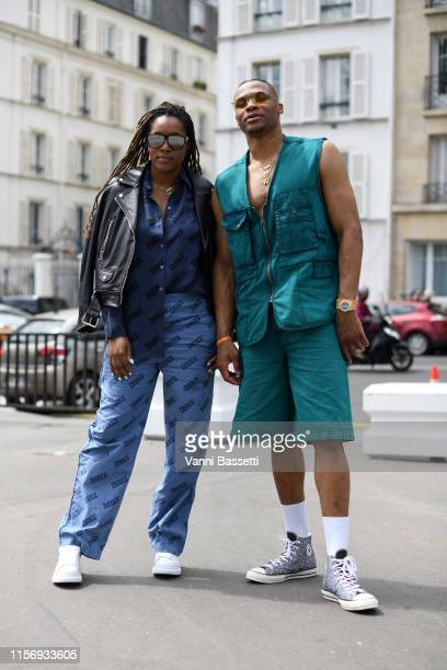 Nina Earl and Russell Westbrook attend the Acne Studios Menswear Spring Summer 2020 show as part of Paris Fashion Week on June 19 2019 in Paris France