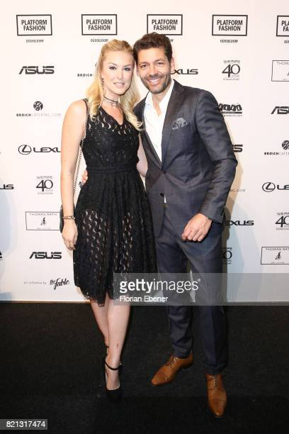Nina Ensmann and Marc Demmig attend the Thomas Rath show during Platform Fashion July 2017 at Areal Boehler on July 23 2017 in Duesseldorf Germany